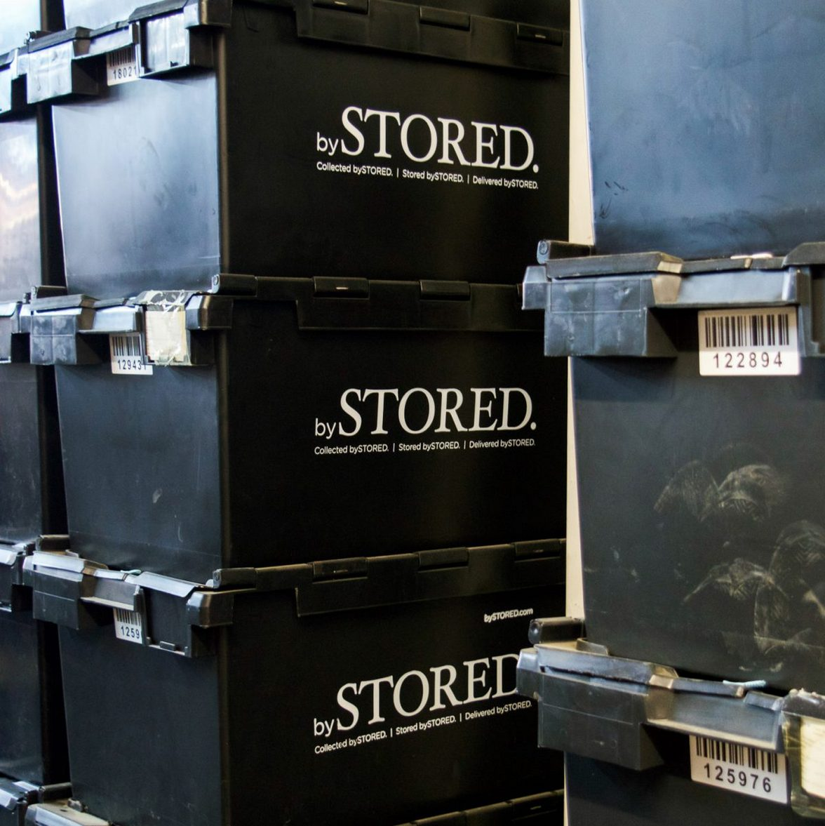 Storage boxes stacked inside a storage facility.