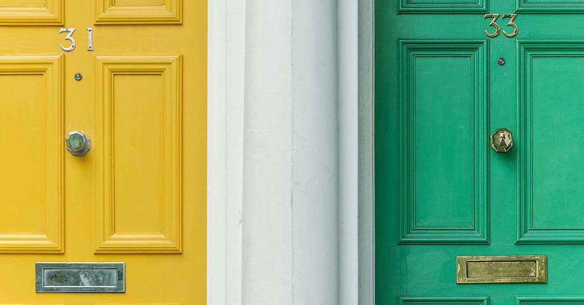 A green and yellow door side by side. Featured image for blog post.