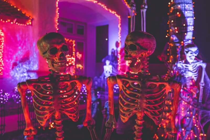 Halloween skeletons in front of a house.