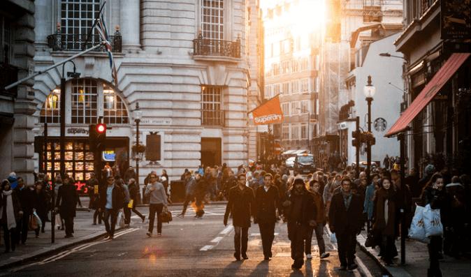 People walking on a street of London.