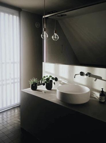 Dark Bathroom With Big Water Tap.