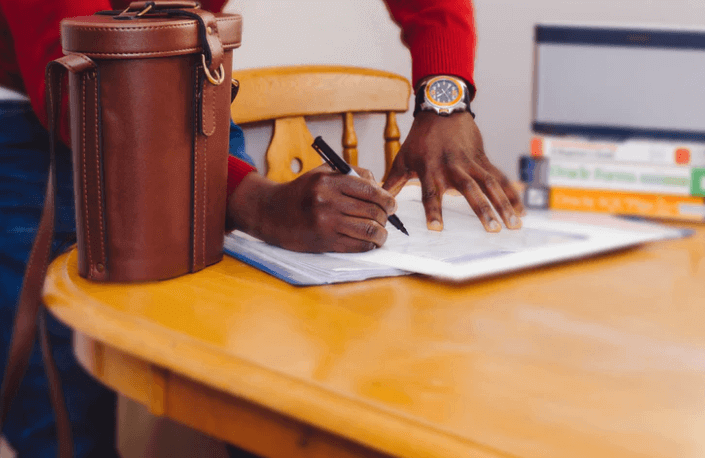 Man Signing on a Document.