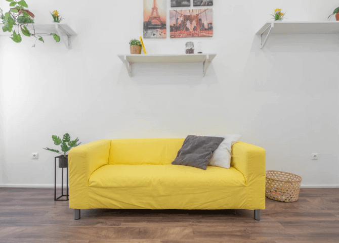 Yellow Sofa With Shelves High Around It.