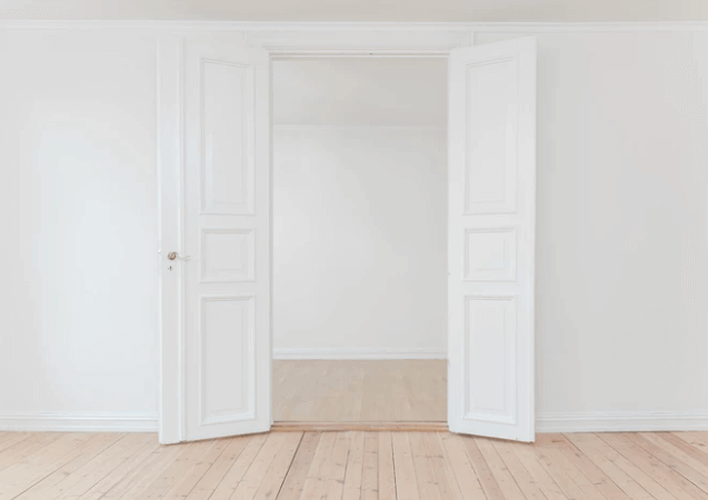 Empty Room With Two White Doors.