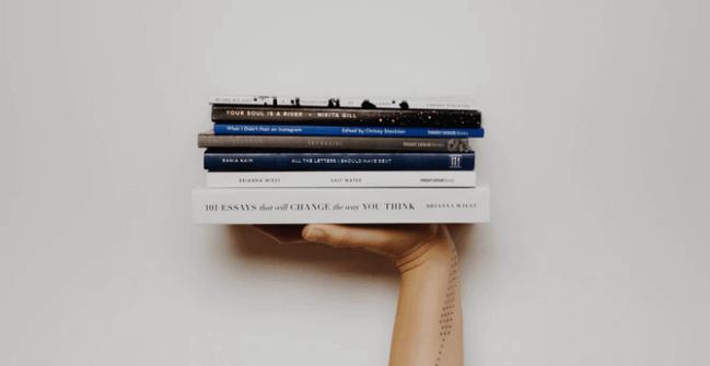 Hand Holding Books.
