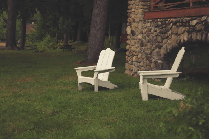 Two Chairs Next to Each Other in Backyard.