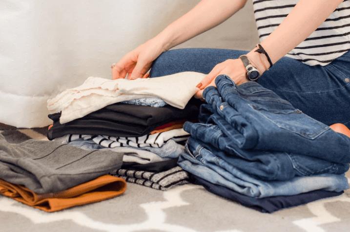 Woman folding clothes.