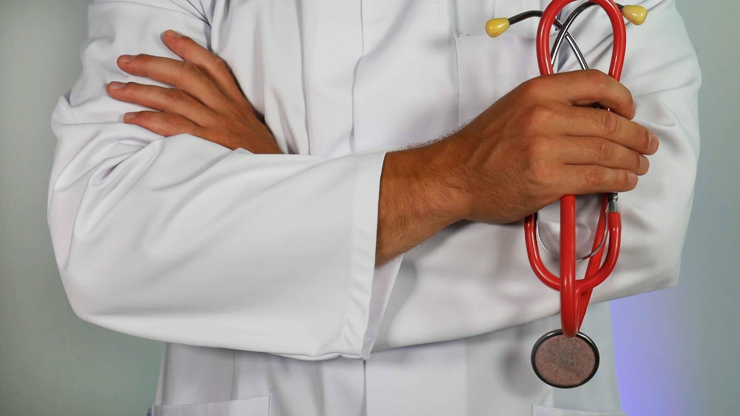 A doctor with his hands crossed.