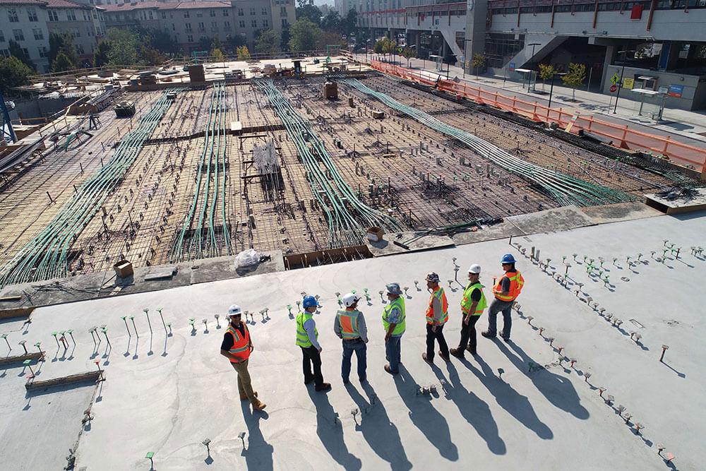 Workers on area that is under development.
