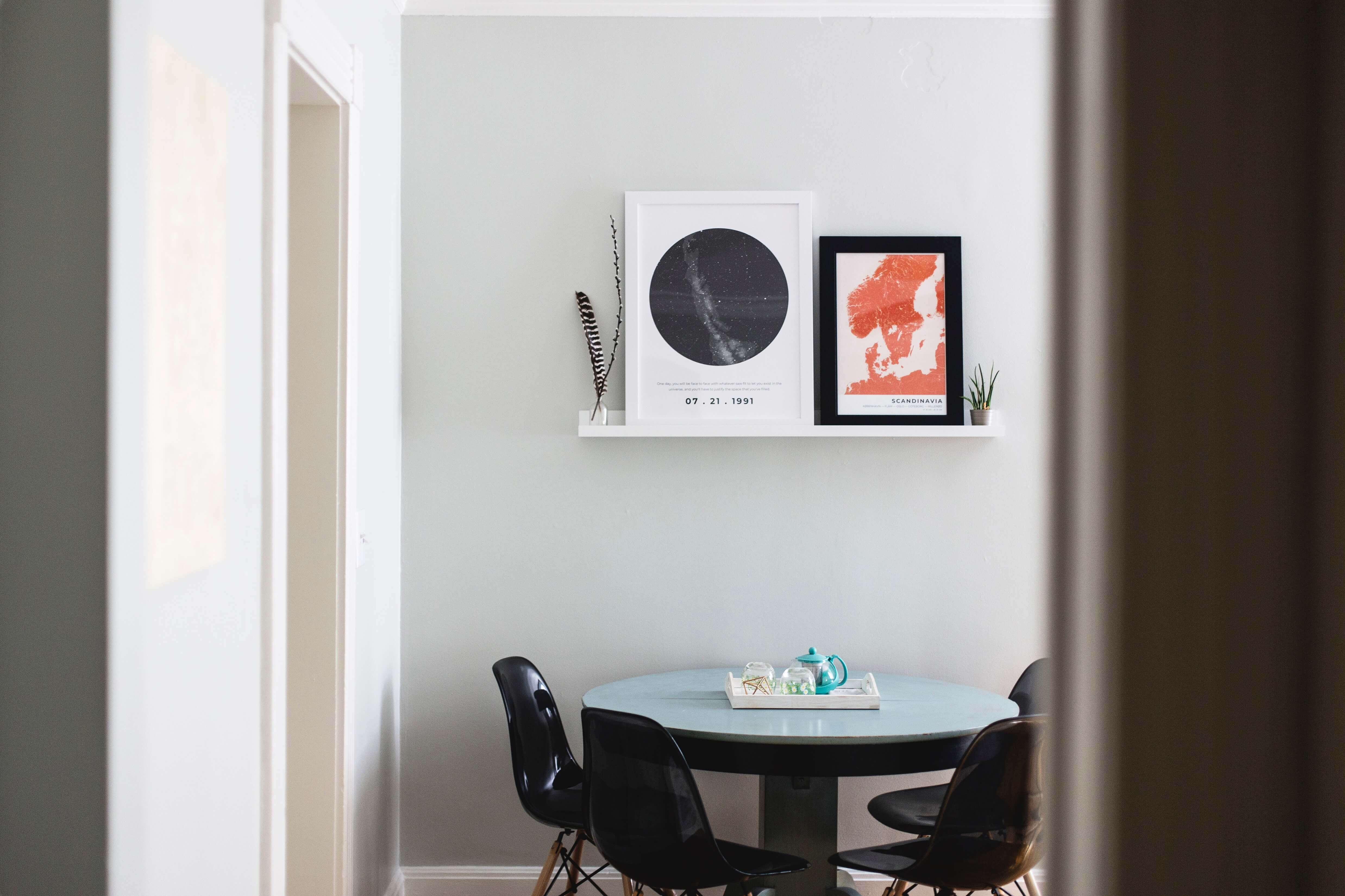 Small round table with black chairs.
