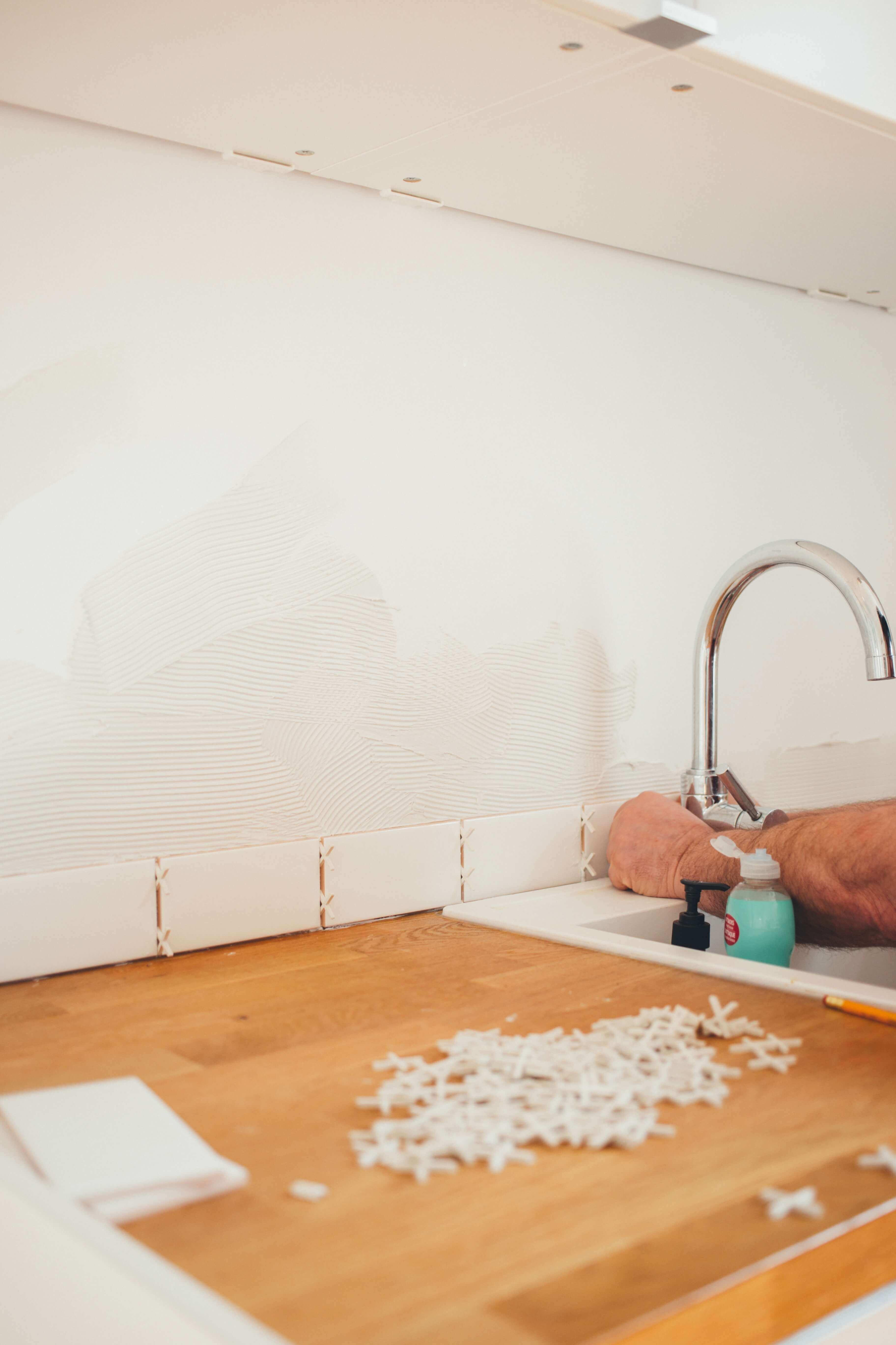 Main repairing a house.