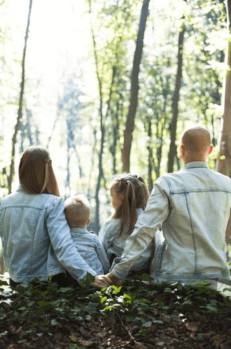 A family in the woods.