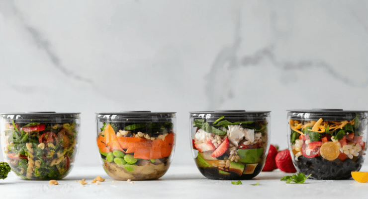 Plastic Bowls Full of Healthy Food.