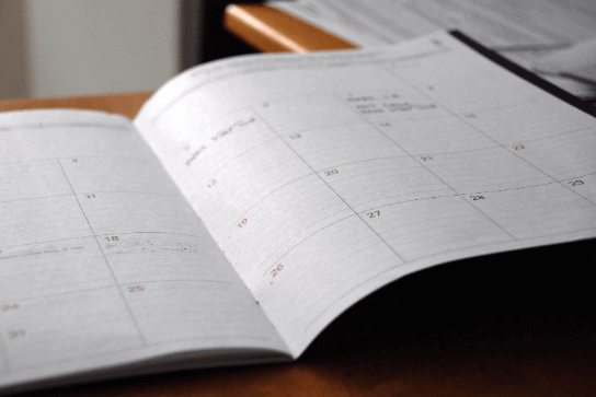 Open calendar on a desk.
