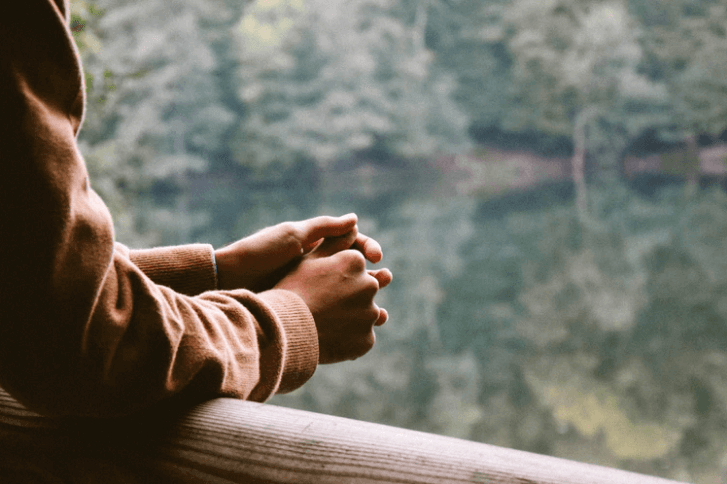 Young Man With Crossed Hands in the Nature.
