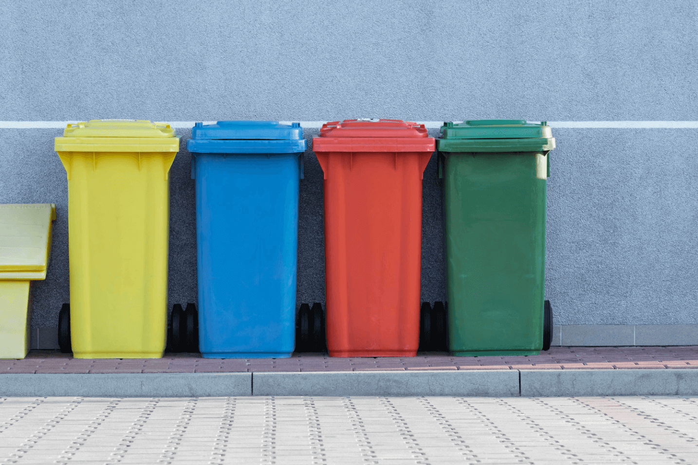Recycling bins in different colors.