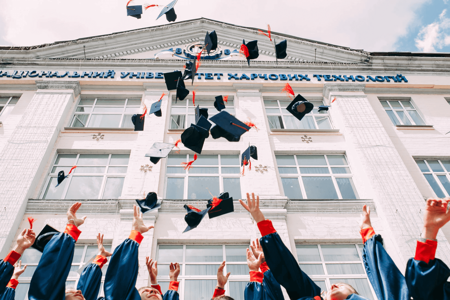 Students throwing their hats in the air on the their graduation day.