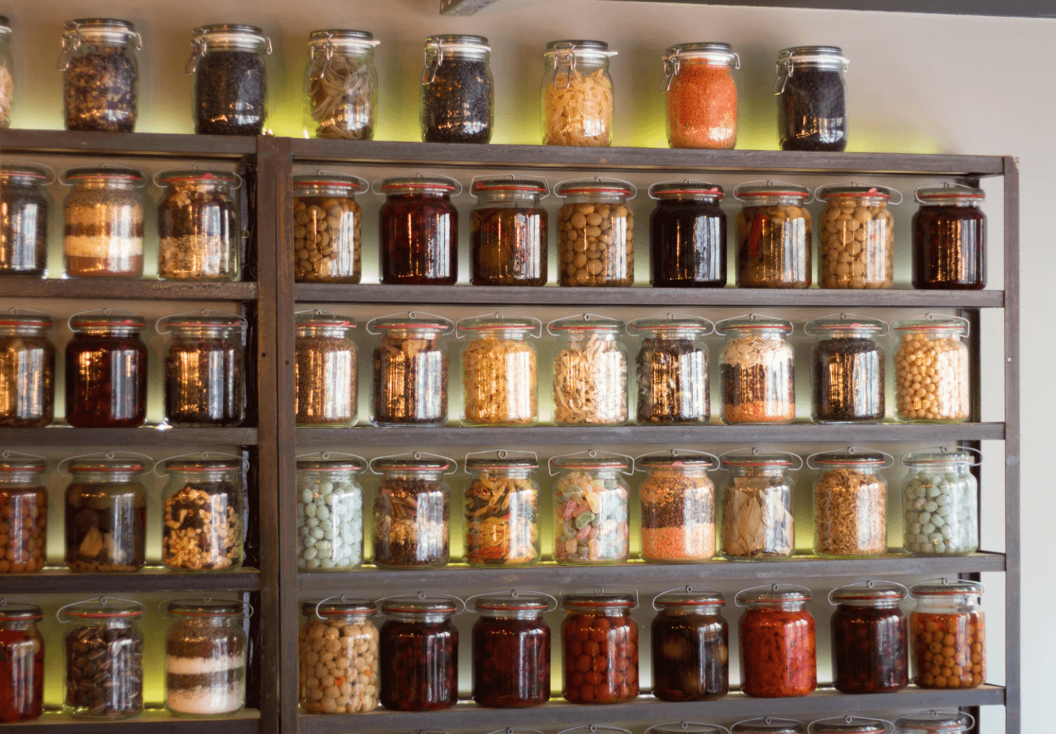 Jars of different colors stored.
