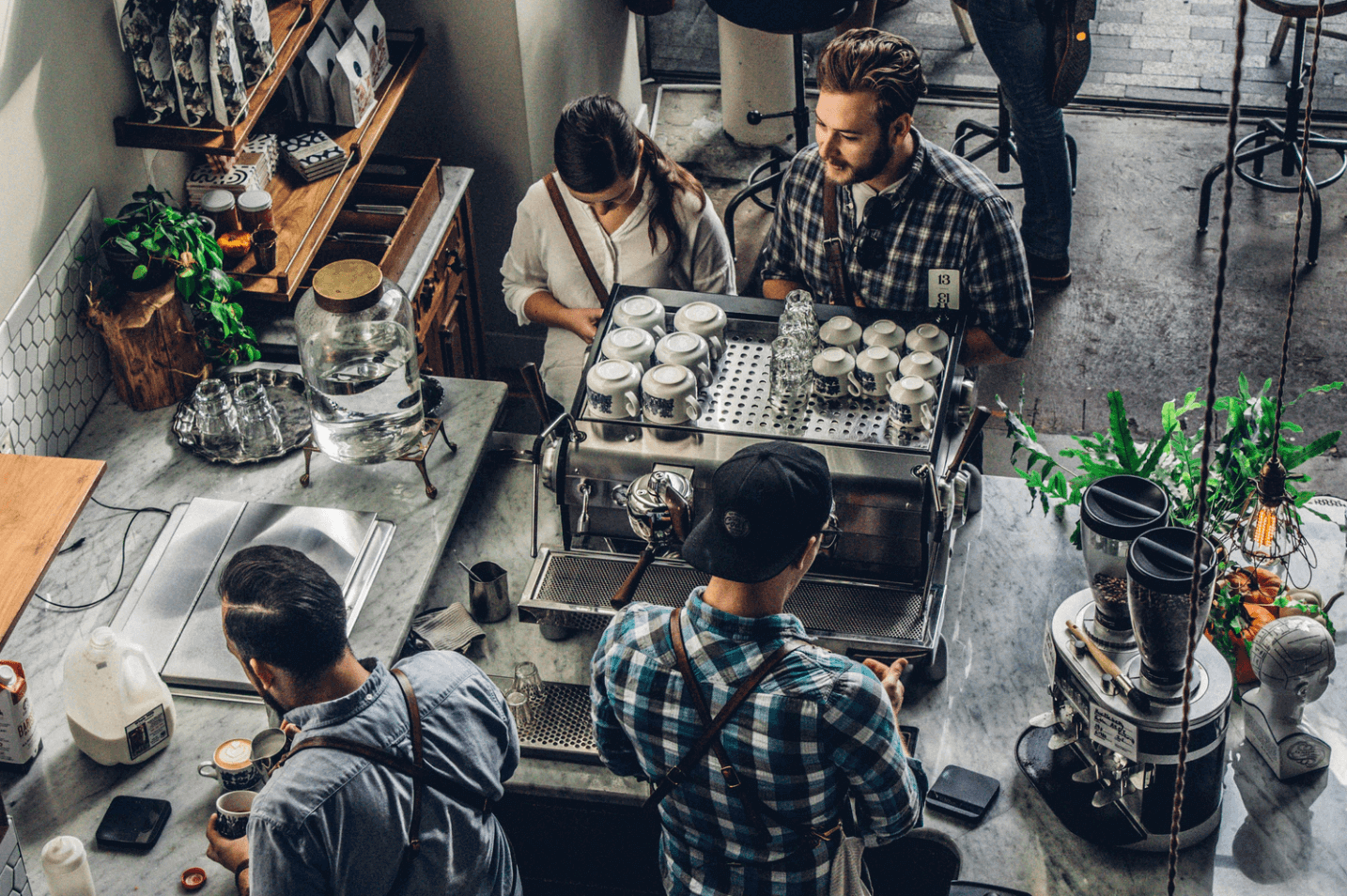 Young people working in a modern cafe.